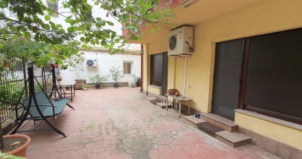 Piata Unirii-apartament 3 camere,singur curte 80mp-parter